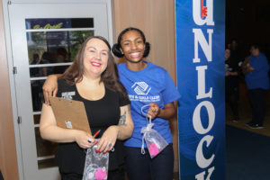 Youth of the Year Teya Shearer and Club Director Amber Barnes selling Blue Door Raffle keys