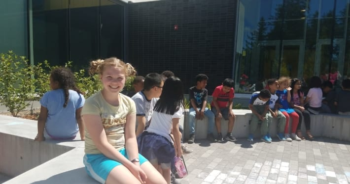 Kids in courtyard before the start of the Peace Pole Planting Ceremony out at Rockwood Boys & Girls Club