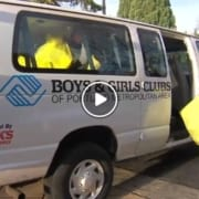Boys & Girls Clubs Staff load toy drive yellow bags into van