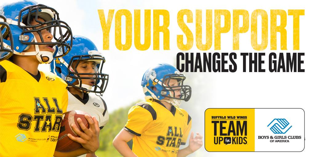 """Three youth in football helmets playing on a field with the caption """"Your Support Changes the Game"""" promoting Buffalo Wild WIngs Community Day on April 17, 2019"""