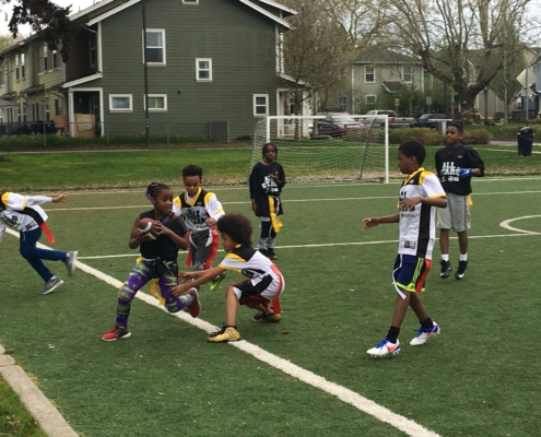 Youth on the Field Playing Flag Football
